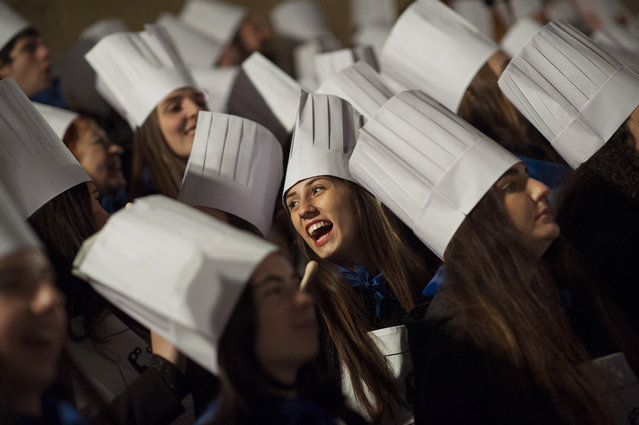 """""""Tamborilleros"""" wearing their uniforms participate in the opening ceremony of the main day of San Sebastian feasts at midnight in the Basque city of San Sebastian, northern Spain, Wednesday, January 20, 2016. (Photo by Alvaro Barrientos/AP Photo)"""