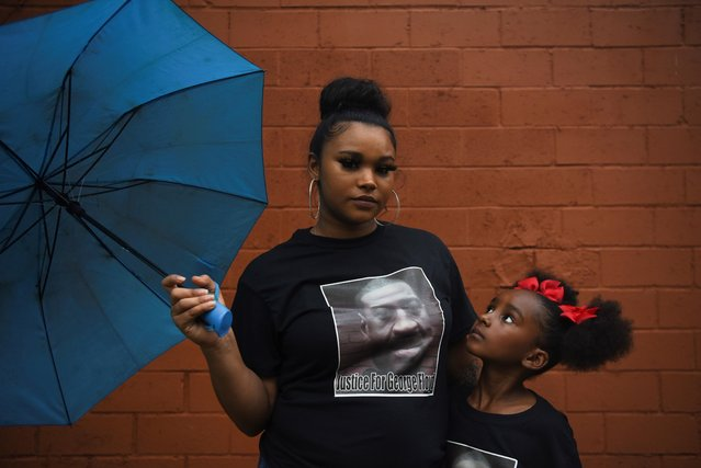 Mother and daughter Brittany and Brooklyn Elmore pose for a portrait in front of a mural of George Floyd ahead of the anniversary of Floyd's death in Houston, Texas, U.S., May 23, 2021. (Photo by Callaghan O'Hare/Reuters)