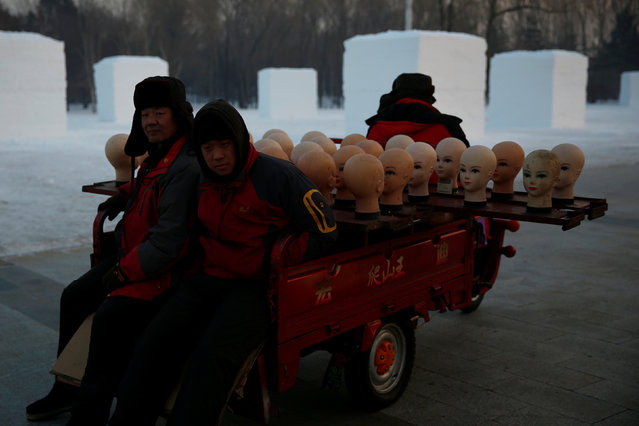 Workers transport heads of models as they prepare to sell hats at the upcoming Harbin International Ice and Snow Sculpture Festival, in Harbin, Heilongjiang province, China, December 17, 2016. (Photo by Aly Song/Reuters)