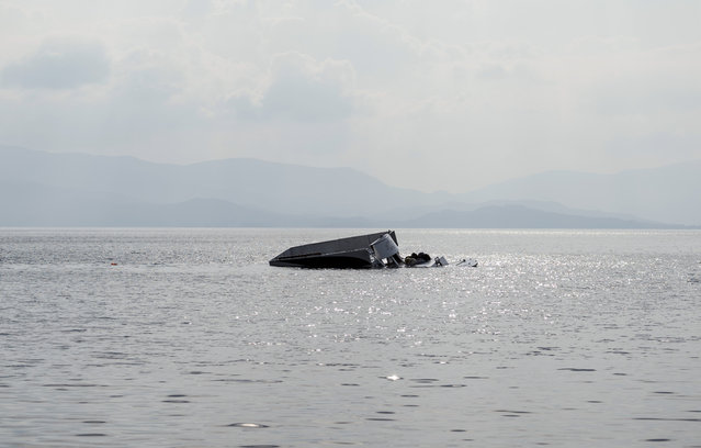 The remains of the boat that was carrying migrants seen off the shore near the Aegean town of Ayvacik, Canakkale, Turkey, Saturday, January 30, 2016. (Photo by Halit Onur Sandal/AP Photo)