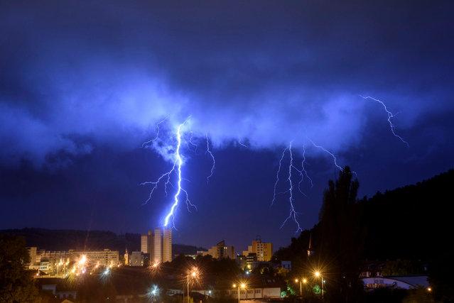 Lightning bolts illuminate the sky during a morning storm over Salgotarjan, Hungary, 01 September 2020. (Photo by Peter Komka/EPA/EFE)