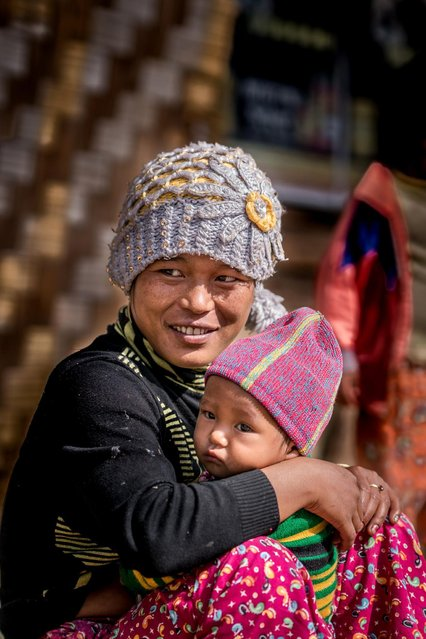 Mother and child in, Mindat, Myanmar, November 2016. (Photo by Teh Han Lin/Barcroft Images)