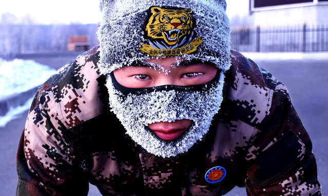 Chinese firefighters take part in a training session in Huzhong, China's coldest town, at Greater Khingan Range in Huzhong, China on November 21, 2018. (Photo by Imaginechina/Rex Features/Shutterstock)