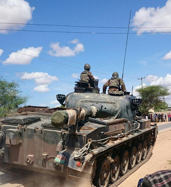 Kenya Defence Forces tank drives outside the Garissa university college, Thursday, April 2, 2015. Al-Shabab gunmen attacked Garissa University College in northeast Kenya early Thursday, targeting Christians and killing at least 15 people and wounding 60 others, witnesses said. (Photo by AP Photo/Stringer)