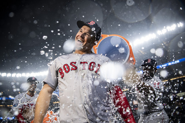 Brock Holt #12 of the Boston Red Sox is doused with Gatorade after hitting for the cycle after game three of the American League Division Series against the New York Yankees on October 8, 2018 at Yankee Stadium in the Bronx borough of New York City. (Photo by Billie Weiss/Boston Red Sox/Getty Images)