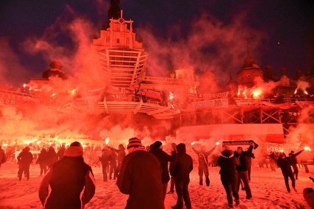 Polish soccer fans light flares as they gather on their annual pilgrimage to the Jasna Gora sanctuary in Czestochowa, Poland January 7, 2017. (Photo by Lukasz Kolewinski/Reuters/Agencja Gazeta)