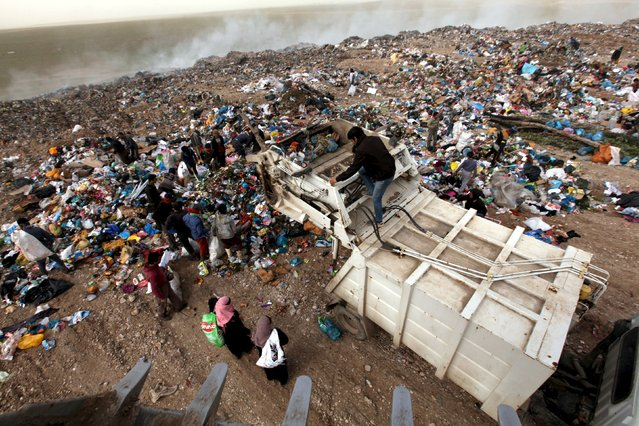 Garbage pickers collect recyclable materials at a garbage dump in Erbil, in Iraq's northern autonomous Kurdistan region, February 21, 2016. (Photo by Azad Lashkari/Reuters)