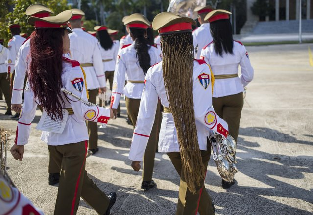 In this October 25, 2018 file photo, the honor guard military band march after the arrival of El Salvador's President Salvador Sanchez Ceren at Revolution Square in Havana, Cuba. (Photo by Desmond Boylan/AP Photo)