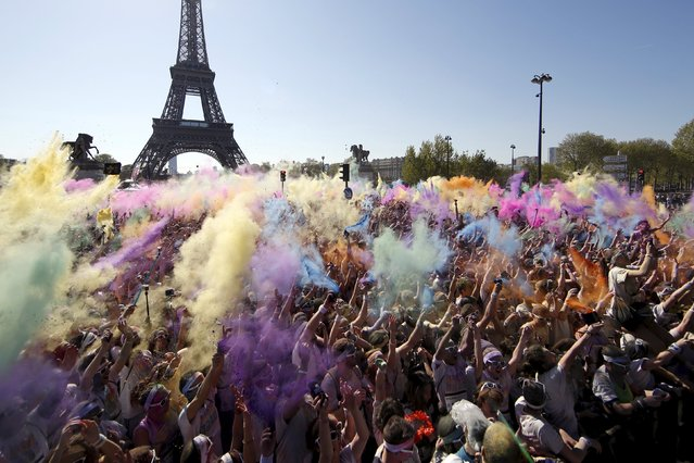 Participants take part in the Color Run near the Eiffel Tower in Paris April 19, 2015. (Photo by Benoit Tessier/Reuters)