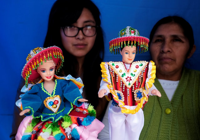 """Artisans show dolls wearing Aymara typical clothes during the """"Alasitas"""" fair, where people buy miniature versions of goods they hope to acquire in real life, in La Paz, Bolivia, January 24, 2017. (Photo by David Mercado/Reuters)"""