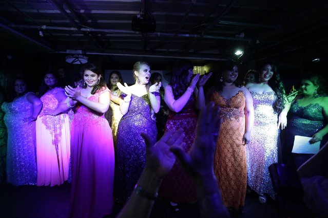 "Contestants celebrate on stage in the ""Miss Gordita"" beauty contest grand finale, in Asuncion, Paraguay, Saturday, April 25, 2015. Even as event organizers try to fight discrimination against plus-size women, awards for contestants include appointments with a nutritionist and annual gym memberships. (Photo by Jorge Saenz/AP Photo)"