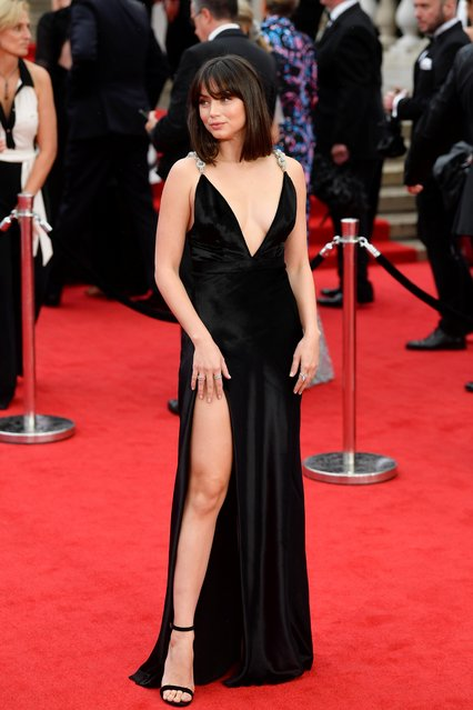 """Cuban actor Ana de Armas poses on the red carpet after arriving to attend the World Premiere of the James Bond 007 film """"No Time to Die"""" at the Royal Albert Hall in west London on September 28, 2021. Celebrities and royals walk the red carpet in central London on Tuesday for the star-studded but much-delayed world premiere of the latest James Bond film, """"No Time To Die"""". (Photo by Toby Melville/Reuters)"""