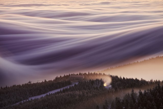 This 800 metre high hills look like they're burning thanks to the beautiful combination of the rising sun and morning mist. (Photo by Martin Rak/Solent News & Photo Agency)