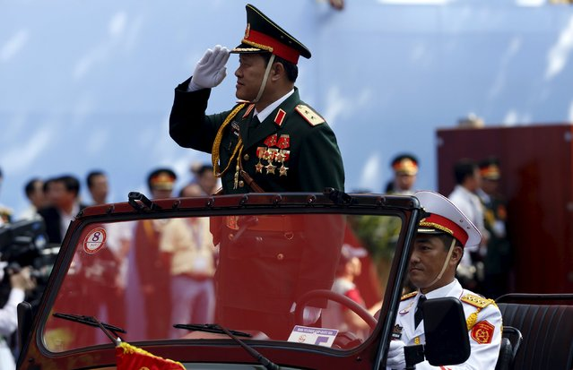 Vietnam's Military Deputy Chief of General Staff Lieutenant General Be Xuan Truong salutes as he leads a military parade as part of the 40th anniversary of the fall of Saigon in Ho Chi Minh City (formerly Saigon), Vietnam, April 30, 2015. (Photo by Reuters/Kham)