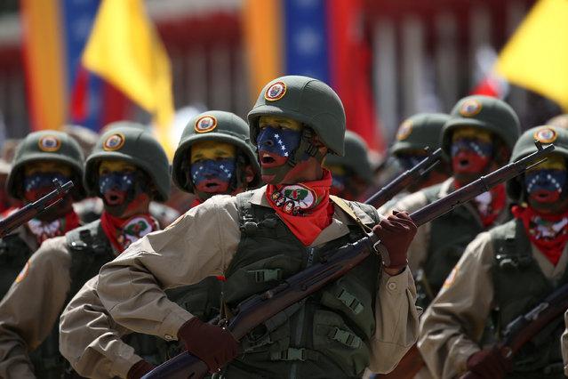 Militia members take part in a military parade in Caracas, Venezuela February 1, 2017. (Photo by Carlos Garcia Rawlins/Reuters)