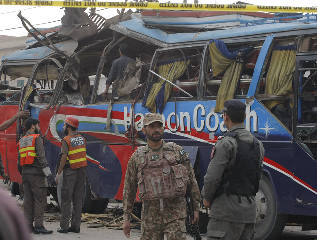 Pakistani security personnel examine a bus following a bomb blast in Peshawar, Pakistan, Wednesday, March 16, 2016. A bomb ripped through a bus carrying Pakistani government employees in the northwestern city of Peshawar on Wednesday, killing 15 people, police said. The explosion took place in an area of the city that houses military institutions and residences. (Photo by Mohammad Sajjad/AP Photo)