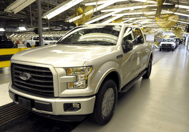 A finished Ford F150 pickup leaves the final inspection station at Ford's Kansas City Assembly Plant where new aluminum intensive Ford F-Series pickups are built in Claycomo, Missouri May 5, 2015. (Photo by Dave Kaup/Reuters)