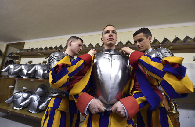 New Vatican Swiss Guards wear their uniforms and armors prior to a swearing-in ceremony, at the Vatican, Wednesday, May 6, 2015. The ceremony is held each May 6 to commemorate the day in 1527 when 147 Swiss Guards died protecting Pope Clement VII during the Sack of Rome. (Photo by Ettore Ferrari/AP Photo/Pool Photo)