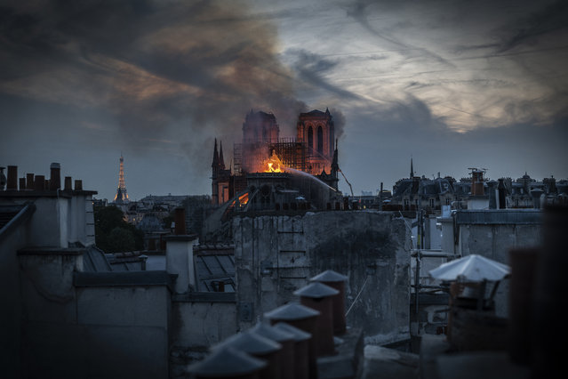 Smoke and flames rise from Notre-Dame Cathedral on April 15, 2019 in Paris, France. A fire broke out on Monday afternoon and quickly spread across the building, collapsing the spire. The cause is yet unknown but officials said it was possibly linked to ongoing renovation work. (Photo by Veronique de Viguerie/Getty Images)