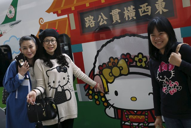Hello Kitty fans pose in front of a Hello Kitty-themed Taroko Express train, in Taipei, Taiwan March 21, 2016. Lucky fans of Hello Kitty were among the first to ride a train themed after the iconic fictional character on its inaugural run in Taiwan on Monday. The Hello Kitty-themed Taroko Express train, the first in Taiwan, set off from the Shulin train station and will travel to Taitung on the east coast route. The Taiwan Railway Administration, which will introduce Hello Kitty merchandise, said it plans to adds more themed trains to its fleet. (Photo by Tyrone Siu/Reuters)