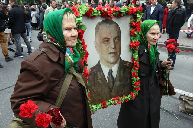 People carry portraits of their relatives who fought in World War II as they take part in the Immortal Regiment march in Kiev, Ukraine on May 9, 2019 to mark the 74th anniversary of the Victory over Nazi Germany in the Great Patriotic War, the Eastern Front of World War II. (Photo by Pyotr Sivkov/TASS)
