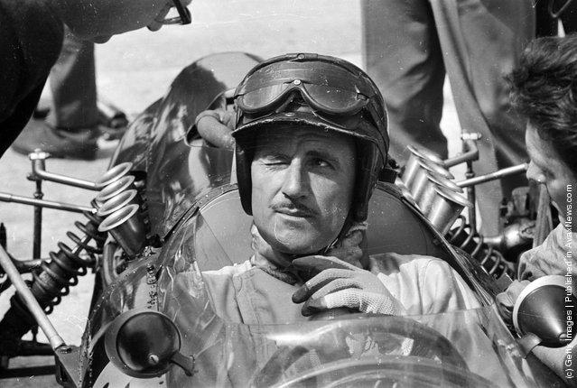 Winking British racing driver Graham Hill
