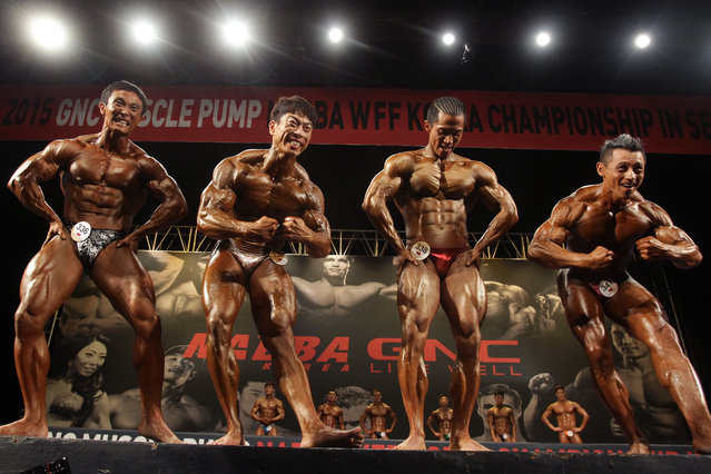 Contestants pose for judges during the NABBA WFF Korea Championship on May 10, 2015 in Seoul, South Korea. (Photo by Chung Sung-Jun/Getty Images)