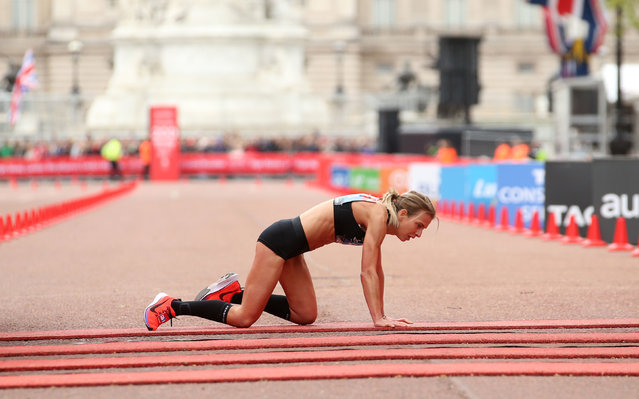 Great Britain's Hayley Carruthers collapses before the finish line in the women's race at the 39th London Marathon in London, Sunday, April 28, 2019. (Photo by Paul Harding/PA Wire Press Association)