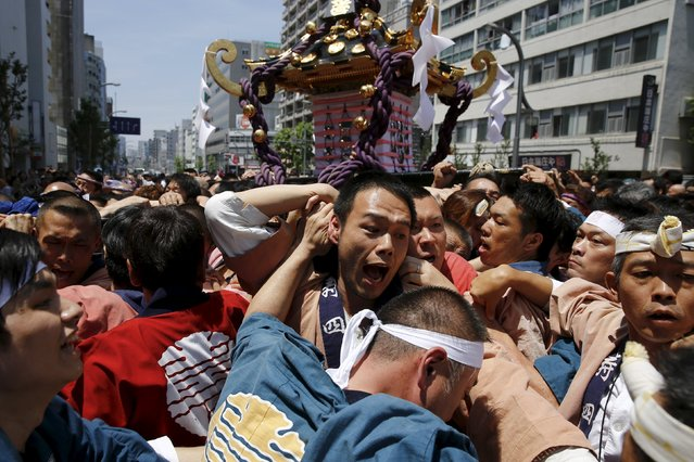 Revellers scuffle over the control of a portable shrine, a Mikoshi, during the Sanja Matsuri festival in the Asakusa district of Tokyo May 17, 2015. (Photo by Thomas Peter/Reuters)