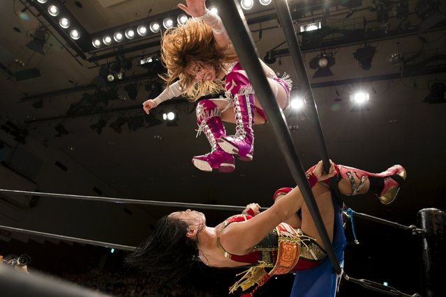 Wrestler Kairi Hojo jumps at her opponent  Mieko satomura during their Stardom female professional wrestling show at Korakuen Hall in Tokyo, Japan, July 26, 2015. (Photo by Thomas Peter/Reuters)