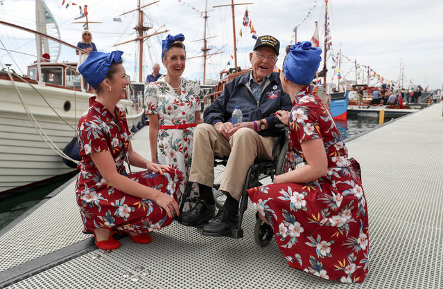 Bert Chandler, an American D-day veteran, meets members of the Charlalas close harmony group during an event at Portsmouth Historic Dockyard in Portsmouth, England on June 2, 2019. (Photo by Andrew Matthews/PA Images via Getty Images)