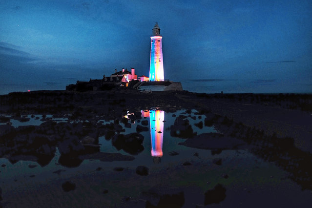 St Mary's lighthouse near Whitley Bay, Northumberland is illuminated with multi-coloured lighting on Wednesday August 22, 2018, for the Whitley Bay Film Festival, which runs from August 16th to September 1st. (Photo by Owen Humphreys/PA Wire)