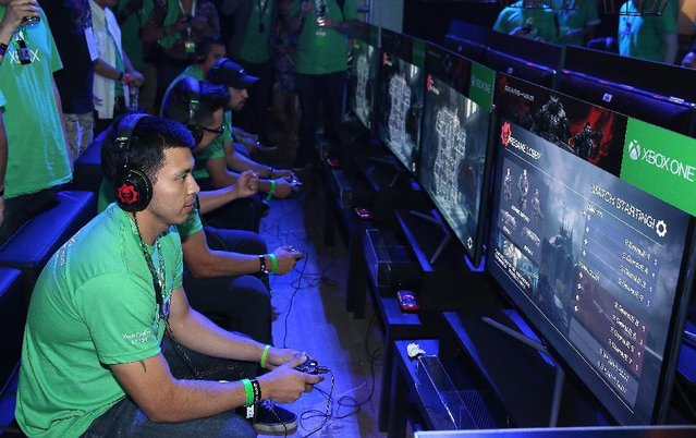 Excited fans get their hands on Gears of War: Ultimate Edition at Xbox FanFest: E3 2015 in Los Angeles on Monday, June 15, 2015. (Photo by Matt Sayles/Invision for Microsoft/AP Images)
