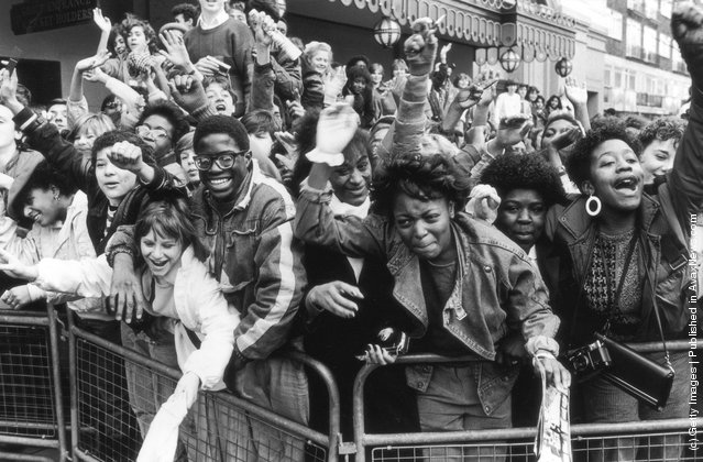 Excited fans of American pop singer Michael Jackson await his arrival, 1985