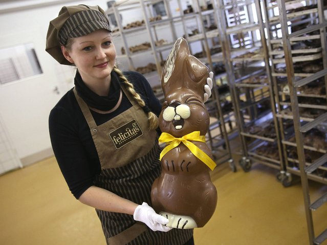 Employee Sandra Jaeckel carries a giant chocolate Easter bunny through the production facility at Confiserie Felicitas chocolates maker in Hornow. (Photo by Sean Gallup/Getty Images)