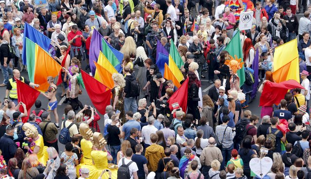 People participate in the annual Christopher Street Day parade on Kurfuerstendamm in Berlin, Germany, June 27, 2015. (Photo by Fabrizio Bensch/Reuters)