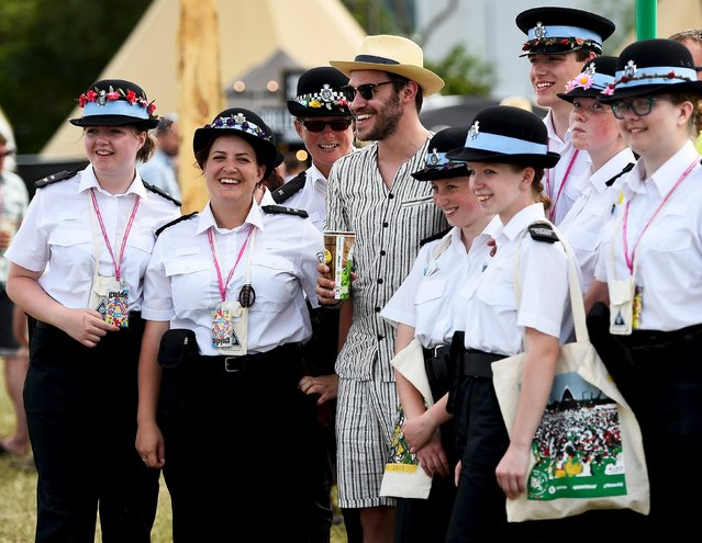 Singer Will Young poses with volunteers at Worthy Farm in Somerset during the Glastonbury Festival in Britain, June 27, 2015. (Photo by Dylan Martinez/Reuters)