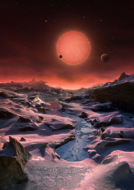 The artist's impression provided by European Southern Observatory on May 2, 2016 shows an imagined view from the surface one of the three planets orbiting an ultracool dwarf star just 40 light-years from earth that were discovered using the TRAPPIST telescope at ESO's La Silla Observatory. It's the first time planets have been found around this type of star – and it opens up new, rich territory in the search for extraterrestrial life. Because this star is so close and so faint, astronomers can study the atmospheres of these three temperate exoplanets and, eventually, hunt for signs of possible life. (Photo by M. Kornmesser/ESO via AP)