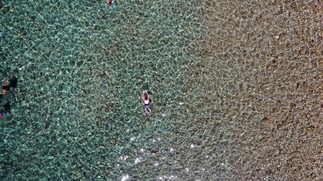 A drone photo shows the people swimming at Dilek Peninsula Buyuk Menderes Delta National Park during the third day of Eid Al-Adha (Feast of the Sacrifice) in Kusadasi district of Aydin, Turkey on August 13, 2019. (Photo by Ferdi Uzun/Anadolu Agency via Getty Images)