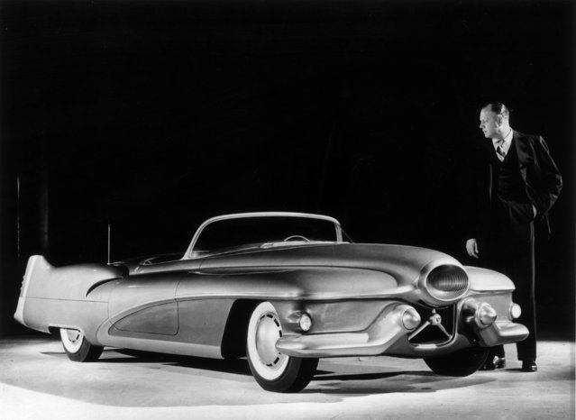 Designer Harley J. Earl of General Motors examining a full scale model of the Buick Le Sabre, a custom made sports car which will be used to test design features for other vehicles. United States, 1951. (Photo by Keystone/Getty Images)