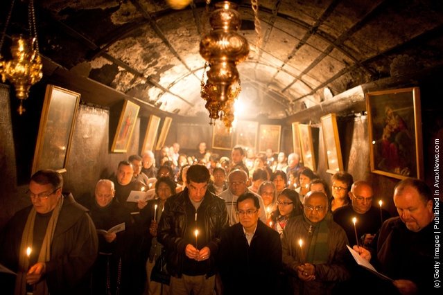 Christian pilgrims pray at the Grotto in the Church of the Nativity in Bethlehem, West Bank