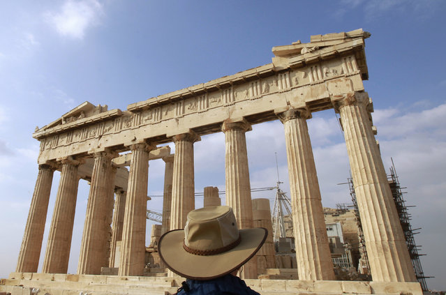 Acropolis: A tourist stands in front of the Parthenon Temple at the archaeological site of the Acropolis Hill in Athens November 3, 2011. (Photo by John Kolesidis/Reuters)