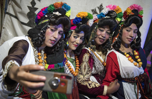 "Young Amazigh (Berber) women pose for a selfie photograph during the annual ""Engagement Moussem"" festival near the village of Imilchil in central Morocco's high Atlas Mountains on September 21, 2019. Each year in the High Atlas Mountains hamlet of Ait Amer, tribes celebrate with dances and music, the collective wedding of young Amazigh couples during the traditional festival of ""Engagement Moussem"". (Photo by Fadel Senna/AFP Photo)"