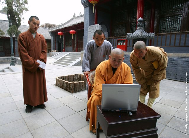 Shi Yongxin, abbot of the Shaolin Temple, works on the computer