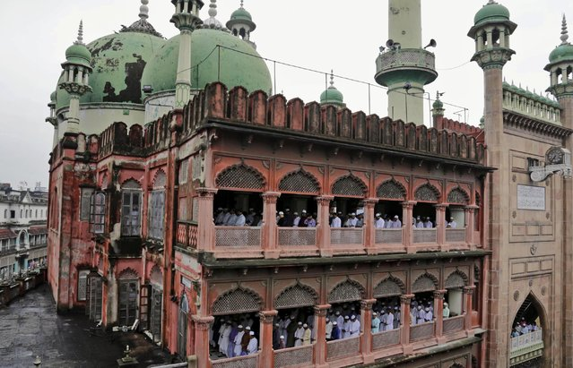 Indian Muslims offer Eid al-Fitr prayers at Nakhoda Masjid in Kolkata, India, Saturday, July 18, 2015. Millions of Muslims across the world are celebrating the Eid al-Fitr holiday, which marks the end of the month-long fast of Ramadan. (Photo by Bikas Das/AP Photo)