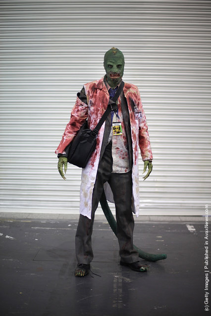 A visitor to the London Super Comic Convention dresses as The Lizard at ExCel