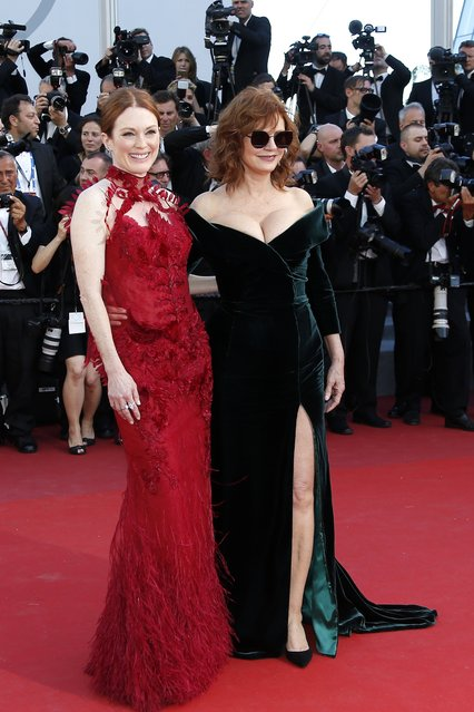 """US actress Julianne Moore (L) and US actress Susan Sarandon (R) arrive for the screening of """"Les Fantomes d'Ismael"""" (Ismael's Ghosts) and the Opening Ceremony of the 70th annual Cannes Film Festival in Cannes, France, 17 May 2017. Presented out of competition, the movie opens the festival which runs from 17 to 28 May. (Photo by Julien Warnand/EPA)"""