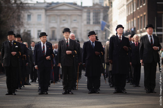 Members of the prestigious 'In and Out Club', one of the oldest and most exclusive clubs in London, cheer as they doff their hats during the club's 150th birthday celebration