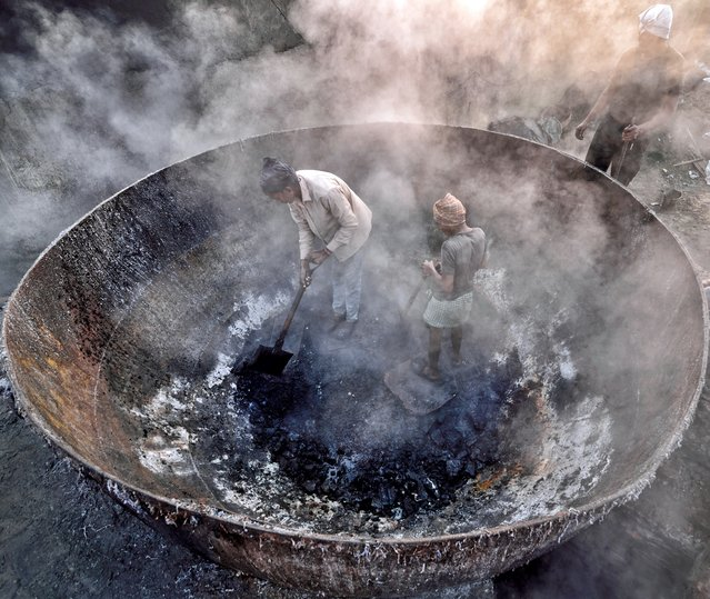 Life in Boiler, West Bengal, India, by Sudipta Dutta Chowdhury. Unloading finished product in the morning. These units burn and boil shaving dust (a by-product of finished leather products), flesh linings and trimmings to make fertiliser and fish feed in Kolkata. The furnaces belch out thick smoke continuously, contributing to Kolkata's poor air quality. (Photo by Sudipta Dutta Chowdhury/2016 Atkins CIWEM Environmental Photographer of the Year)