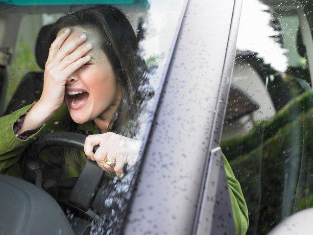 Restive woman driving. (Photo by Cultura Creative (RF)/Alamy Stock Photo )